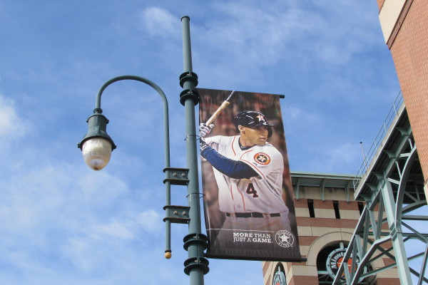 Photo of Astros slugger George Springer on light pole outside Houston's Minute Maid Park