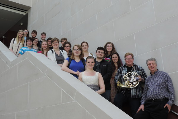 Horn professor William VerMeulen poses with a group of music students from the Eastman School of Music