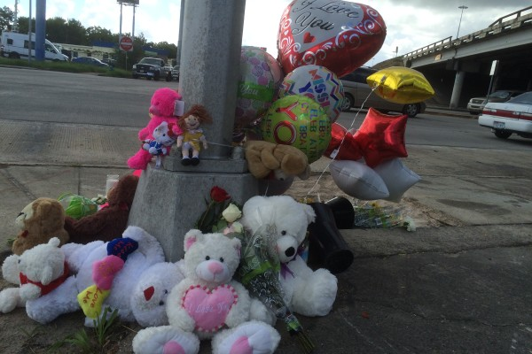 Dozens of Teddy bears and balloons make up the memorial site