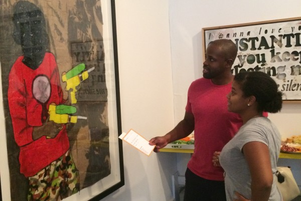Picture of couple looking at art