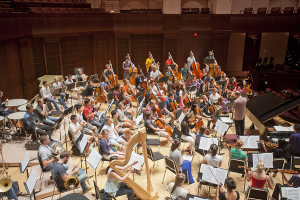 The orchestra rehearses on stage at Rice University