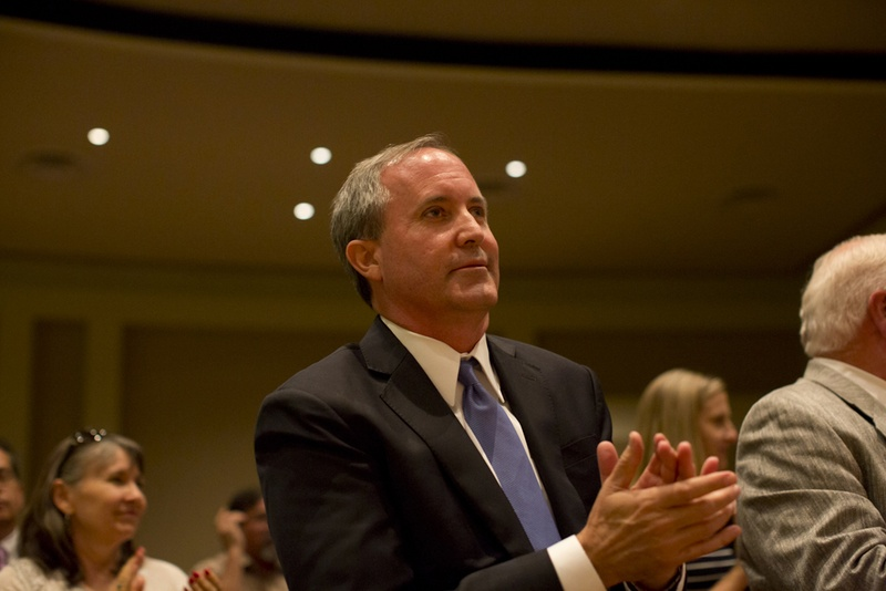 Ken Paxton clapping