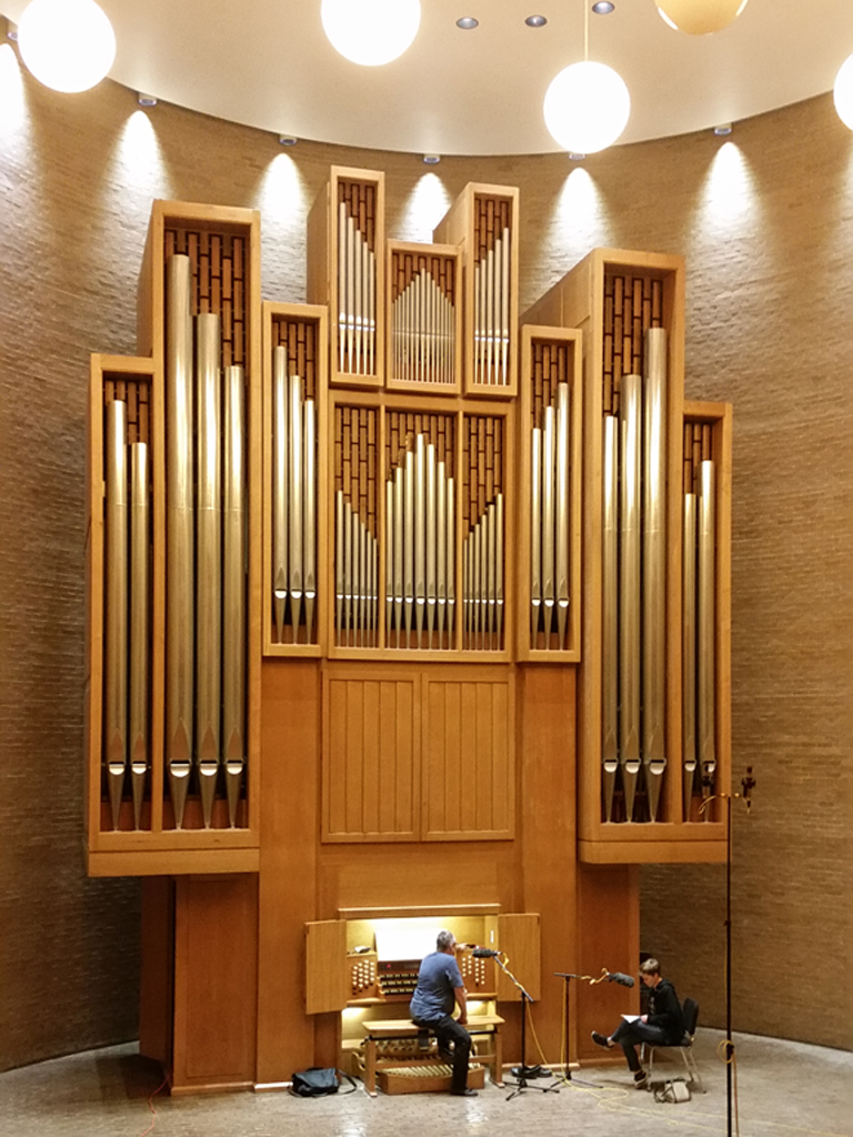 Keith Weber and Dacia Clay. Regular-sized people, giant Beckerath organ.