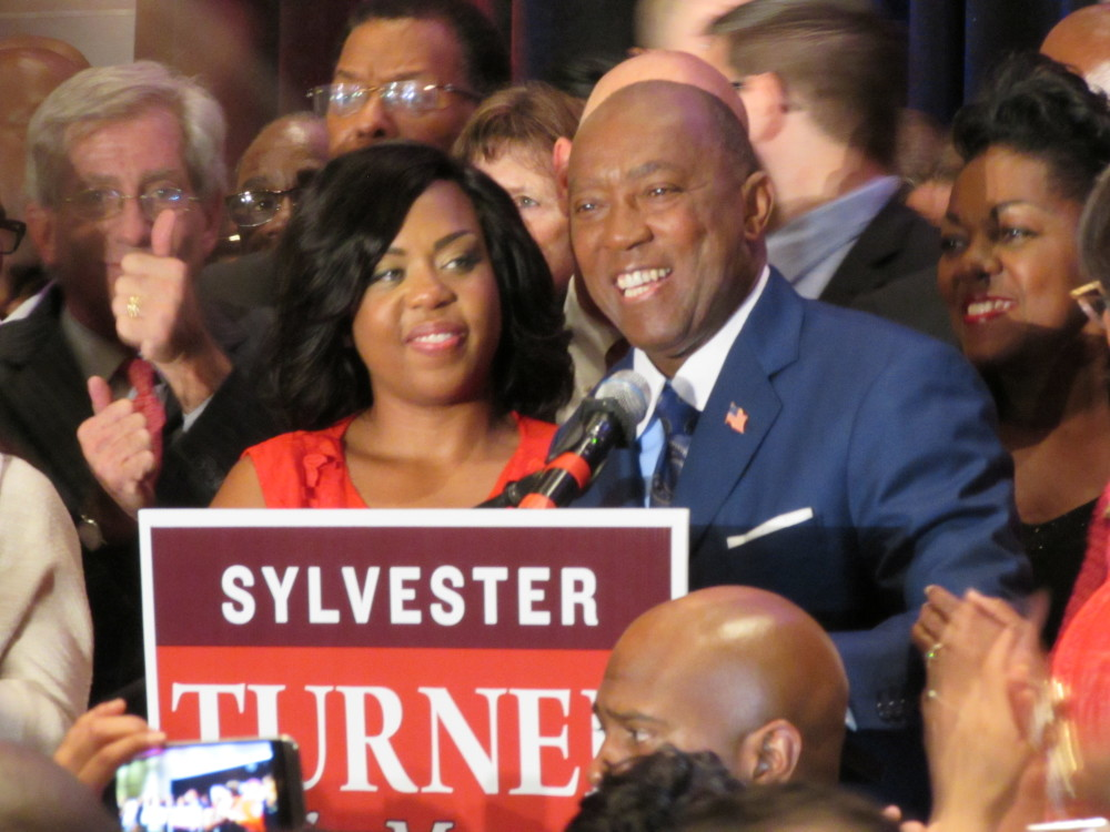 Sylvester Turner stands with his daughter Ashley Turner as he thanks supporters on election night.