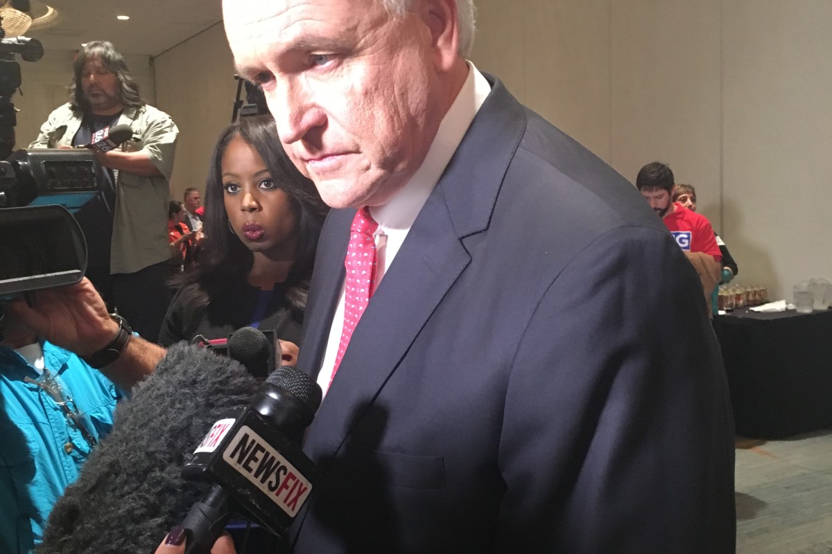 Bill King speaks with reporters