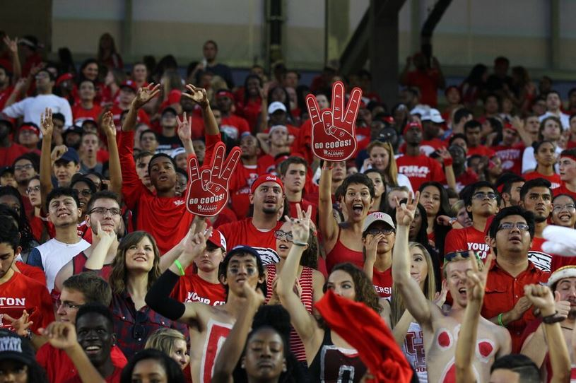 University of Houston football fans cheering from the stands.