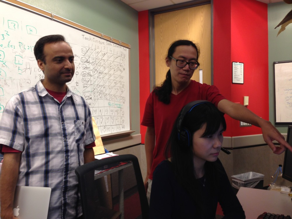 Professors Omprakash Gnawali and Larry Shi work at their lab in the University of Houston.