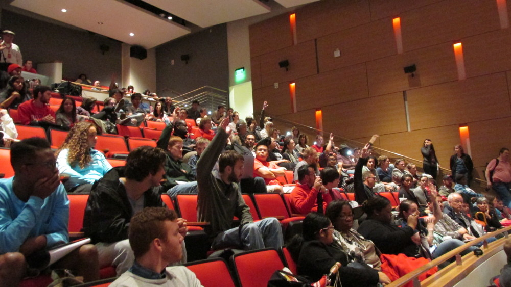 Students and others raise their hands if they have a concealed handgun license at a forum on the new campus carry law. It takes effect next August and will allow licensed holders to carry handguns on public Texas colleges.