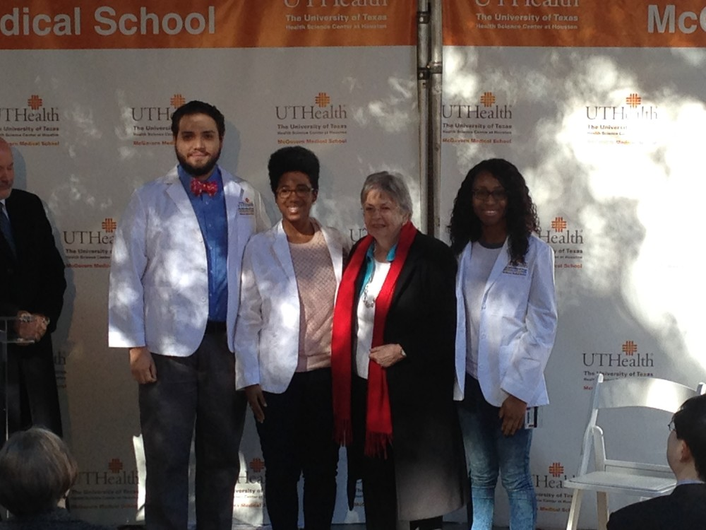 Kathrine G. McGovern, widow of Dr. John P. McGovern, poses with three students from the UT Health Science at Houston during the event where the donation was announced.