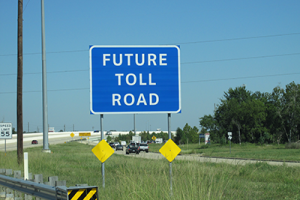 A sign announcing a new toll road in Harris County.