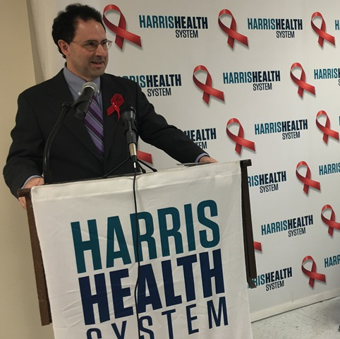 Dr. Ben Barnett is the associate medical director of HIV Services at Harris Health. He is speaking during a World Aids Day event at the Thomas Street Health Center.