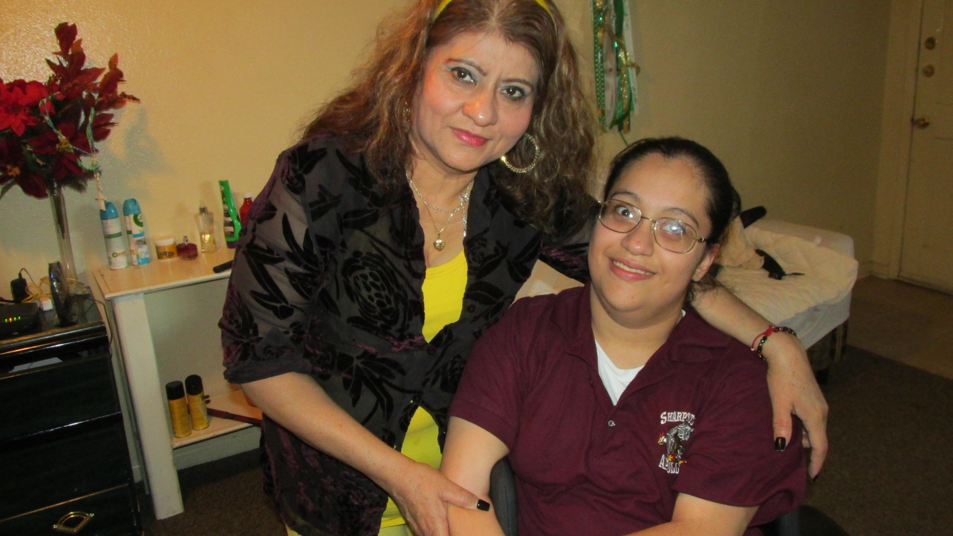 Rosa Aguirre stands with her daughter Lupita, a freshman in high school