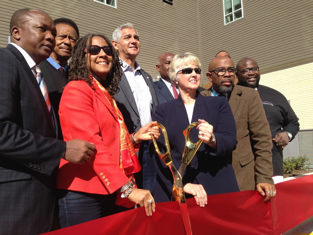 Pastor Juanita Rasmus and Houston Mayor Annise Parker cut the ribbon at the new phase of the Temenos apartment complex, near downtown.