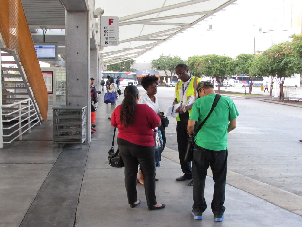 A Metro representative assists riders at the Texas Medical Center transit hub.