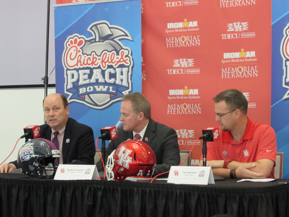 Athletic officials discuss the University of Houston's appearance in the Chick-fil-A Peach Bowl. From left to right are Peach Bowl President Gary Stokan, UH Vice-President of Athletics Hunter Yurachek, and UH head football coach Tom Herman.