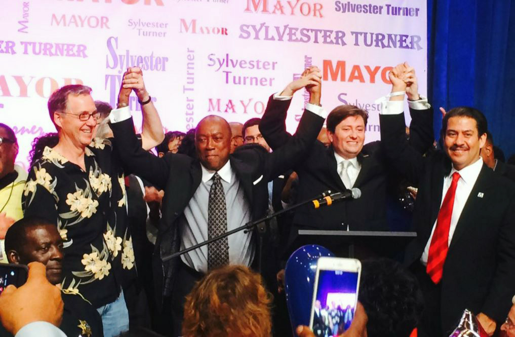 Sylvester Turner holds up hands in victory