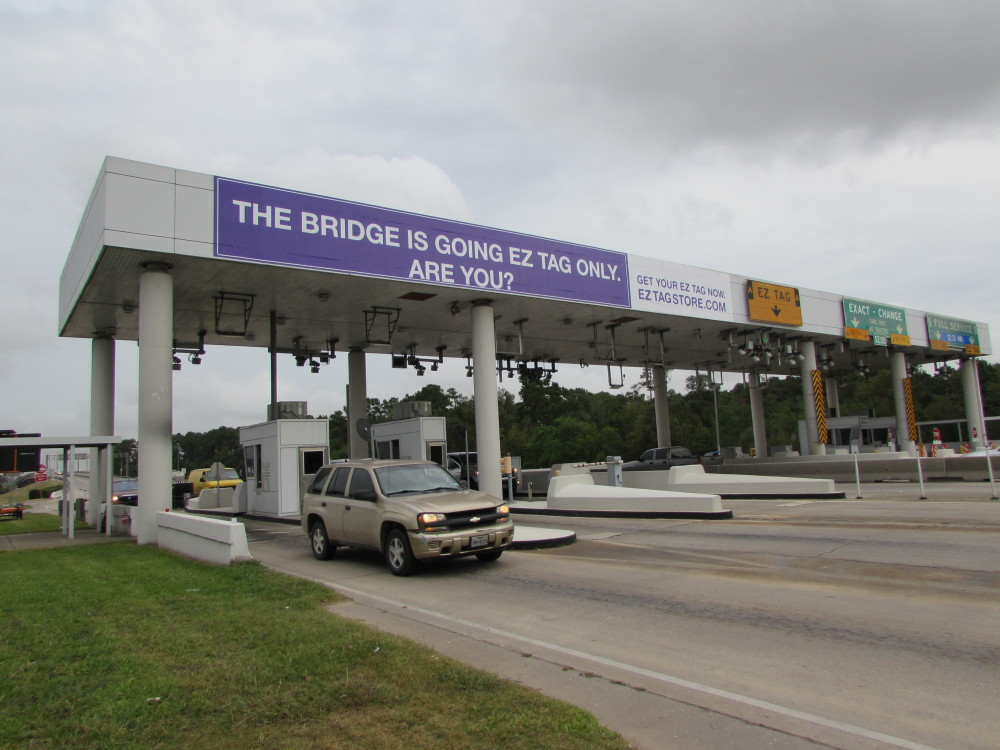 Signs at HCTRA's Ship Channel Bridge advise drivers of change to all-electronic tolling.