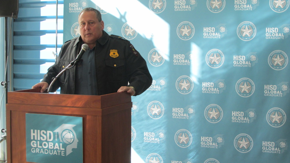 HISD Police Chief Robert Mock stands at a podium and tells reporters that the school system remains on high alert.