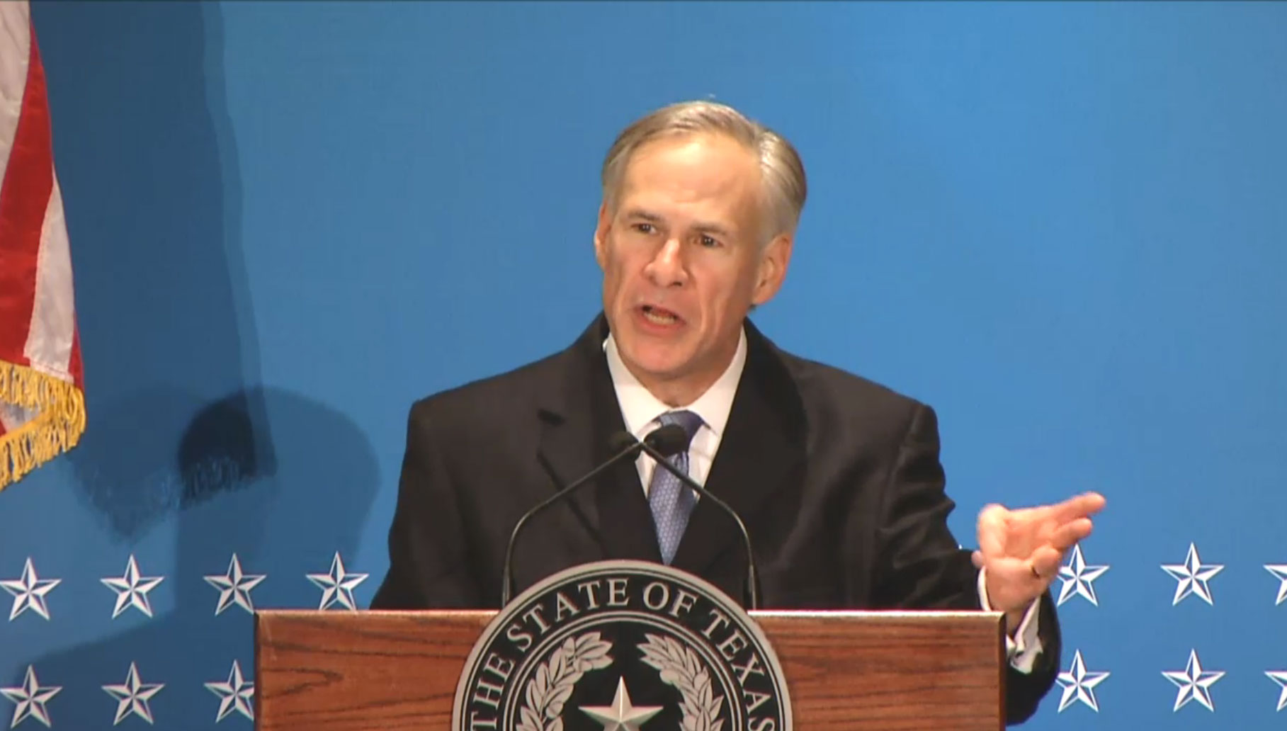 Governor Greg Abbott speaking at the podium