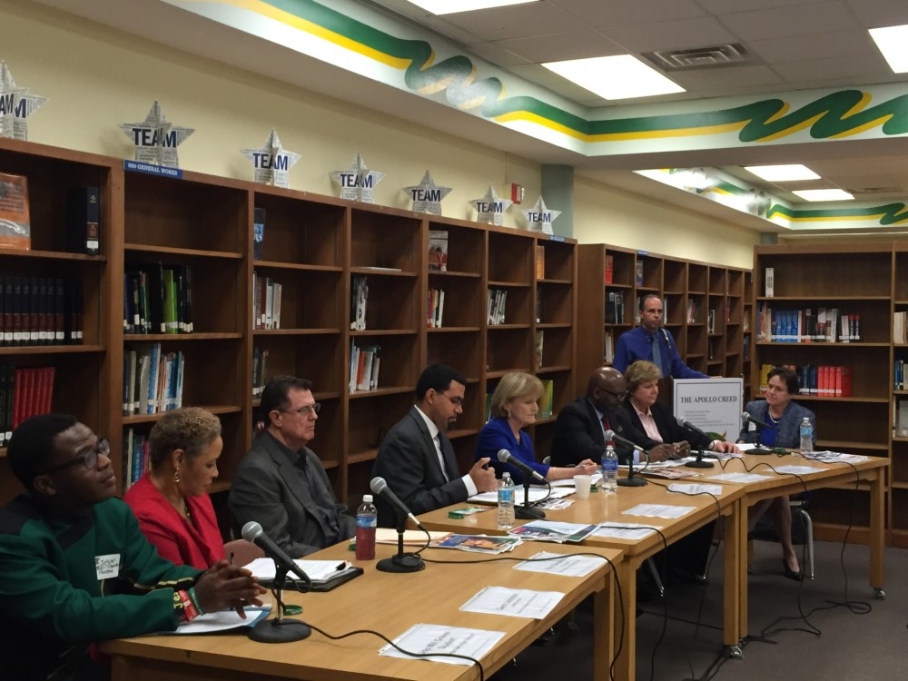 School leaders, community members and students gather at a round table discussion about healthy communities at Sharpstown High School