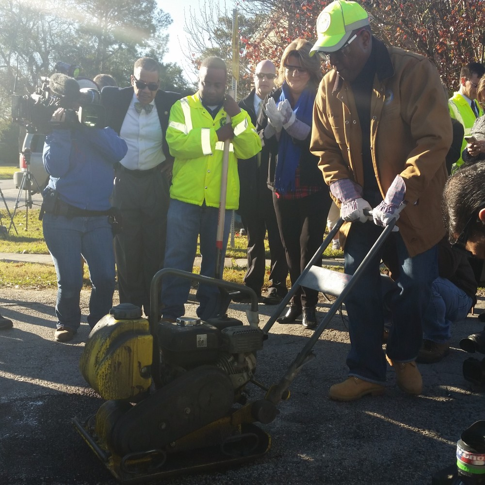 Mayor Turner fixing a pothole