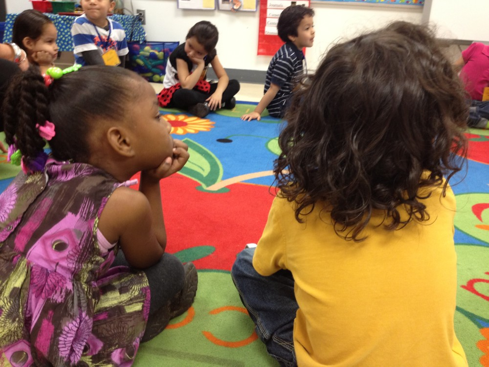 Preschoolers sitting on the floor