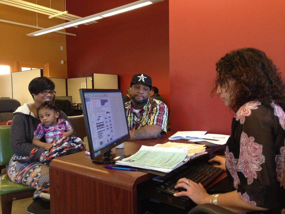From left to right: Ebony Turner, her daughter Jaylen, Timothy Turner and Sonia Gervazio. The Turners went to Neighborhood Centers to get their tax return for 2015 ready free of charge. (Photo: Al Ortiz)