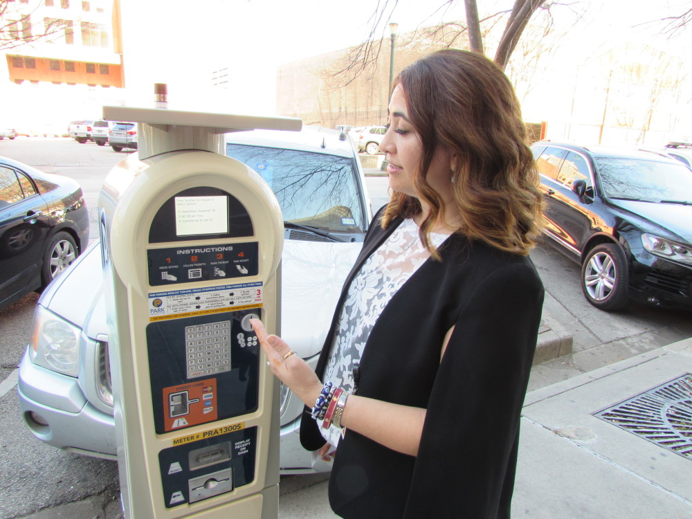 Houston Parking Official Maria Irshad demonstrates new parking meter.