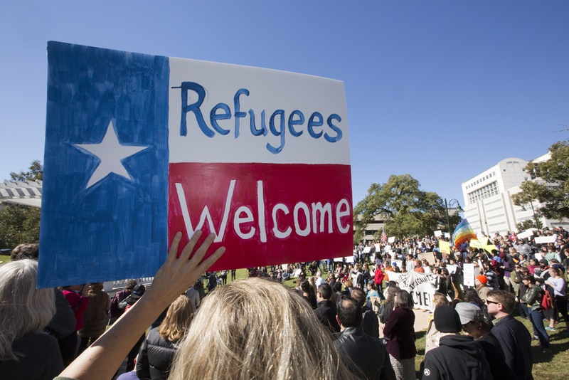 sign held up in support of refugees in Texas