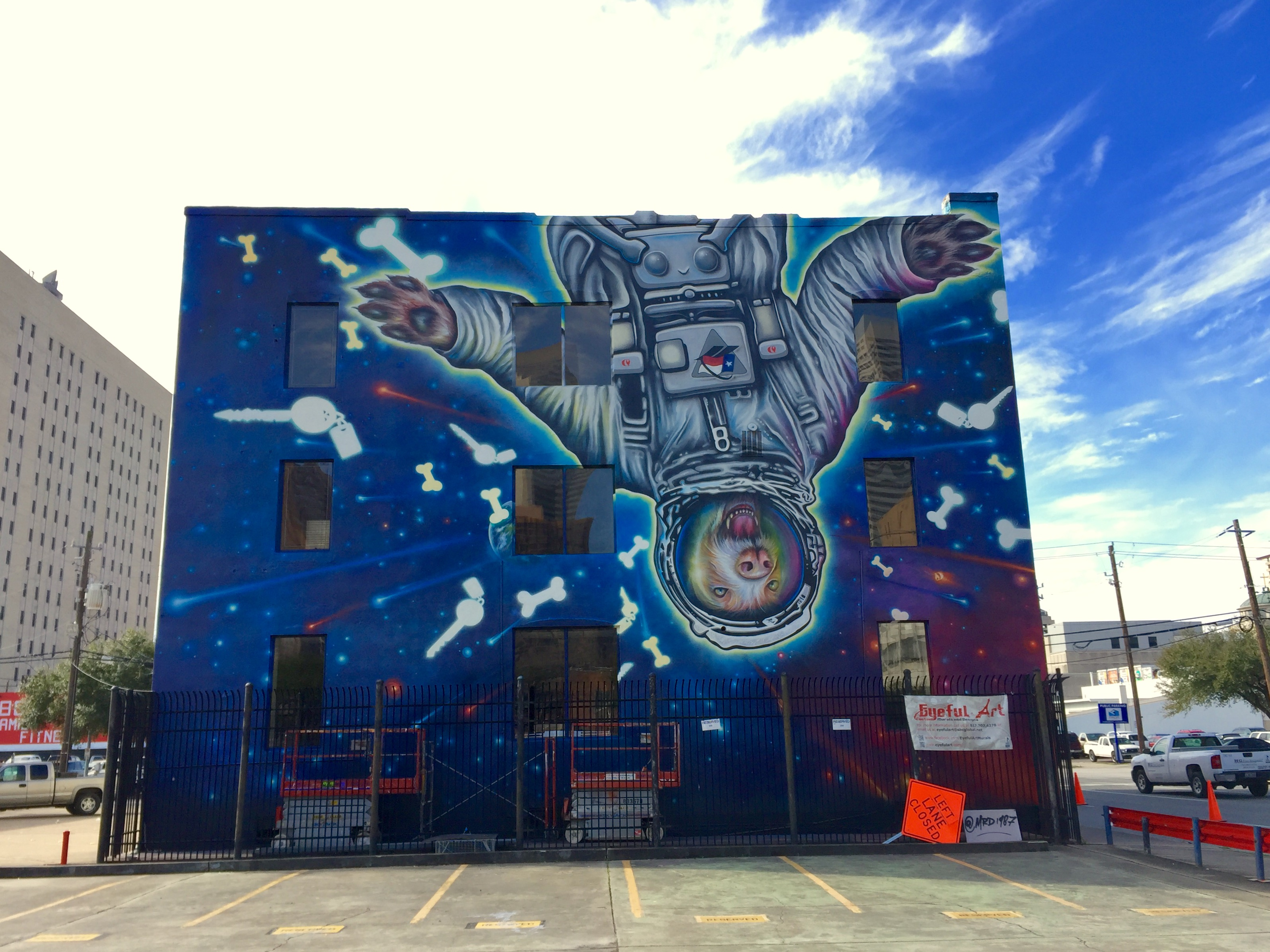 Picture of Space Suite Dog mural on Texas Direct Auto building