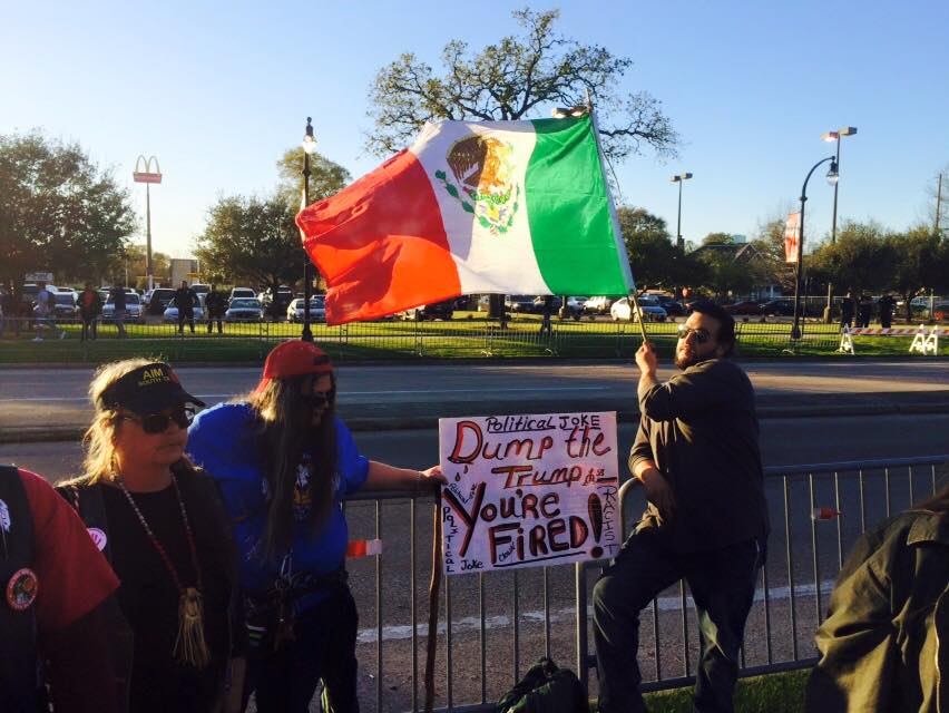 Protesters gather outside the Republican primary debate on the UH campus