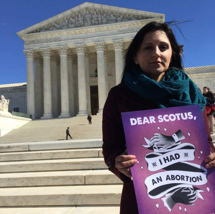 Texan Candice Russell outside the U.S. Supreme Court on the day justices heard arguments on a controversial law regulating abortion providers.