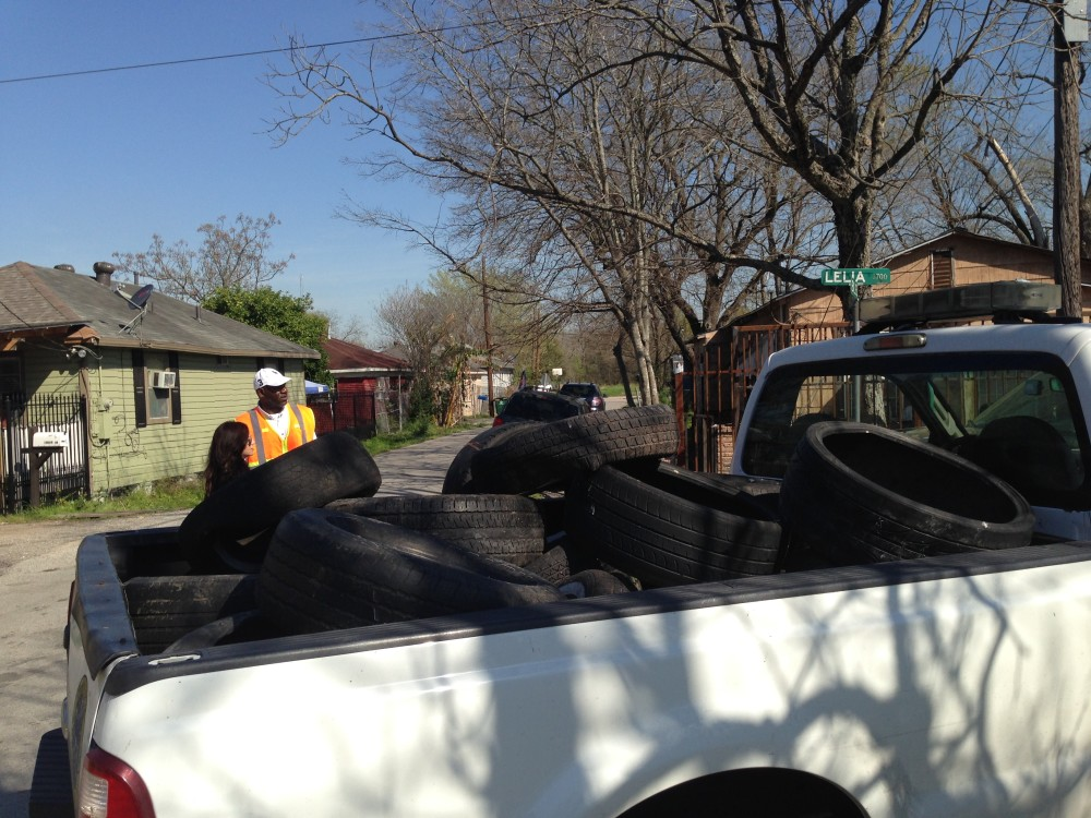 The city's crews remove tires that can also hold water.