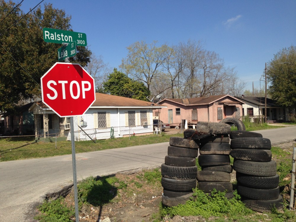 tires dumped by a stop sign