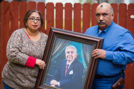 Patty Rodriguez and her brother, Alex, hold a photo of their late father Demetrio Rodriguez Sunday, March 1, 2015 in San Antonio.