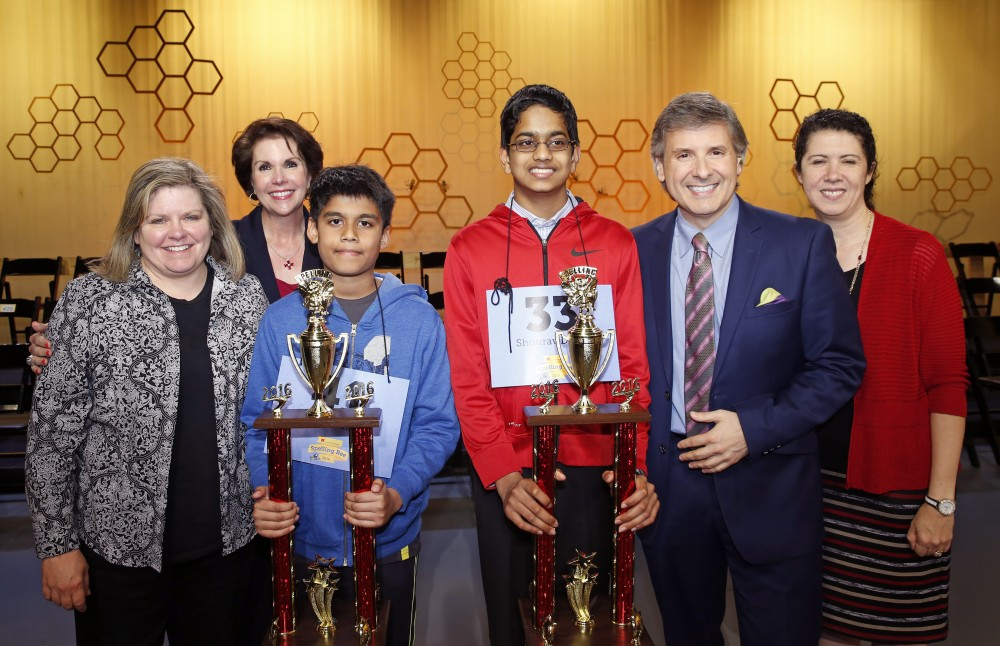 Connie Hill, Lisa Shumate, Ernie Manouse and Capella Tucker of Houston Public Media congratulate the 2016 co-champions, Nihar Janga and Shourav Dasari.