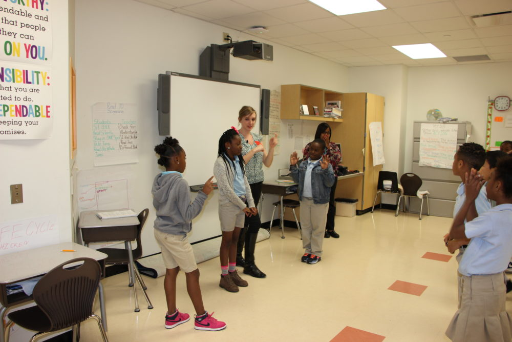 Teaching artist Brandy Reichenberger with Main Street Theater leads third grade students at Atherton Elementary in theater skits and games to reinforce science lessons about light movement.