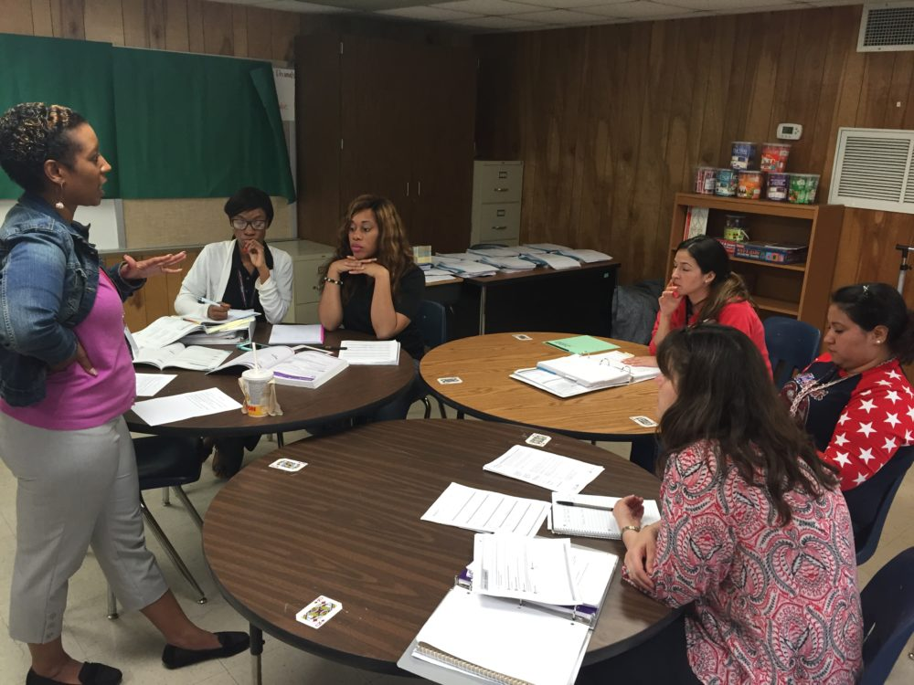 Math specialist Kristin Davis leads a weekly collaborative planning session with all the fourth grade math teachers at Bussey Elementary in Aldine.