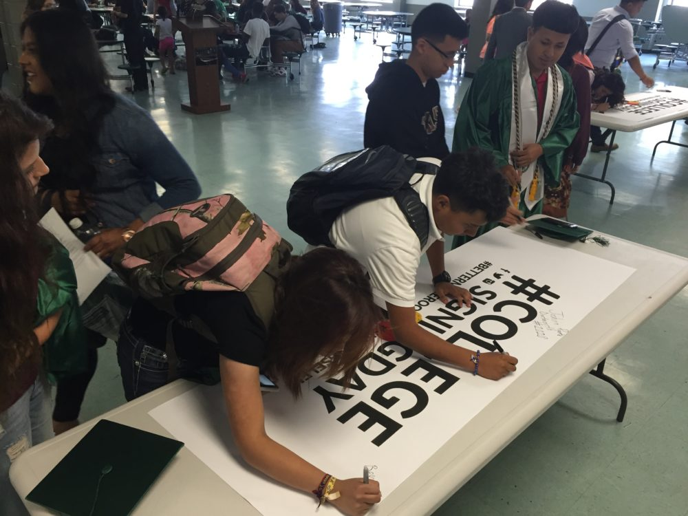 Seniors at Austin High School participate in a college signing day to celebrate their next steps after high school.