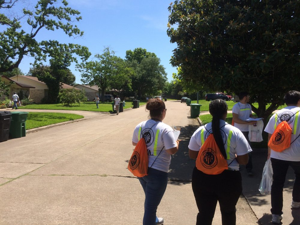 230 employees with the Houston Health Department are going door to door to pass out information on city resources.