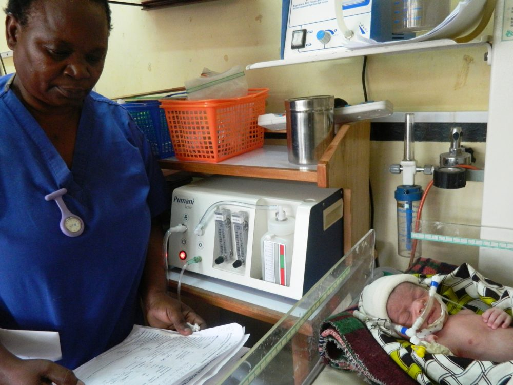Neonatal nurse Florence Mwenifumbo monitors a newborn that is receiving bubble CPAP treatment at Queen Elizabeth Central Hospital in Blantyre, Malawi.