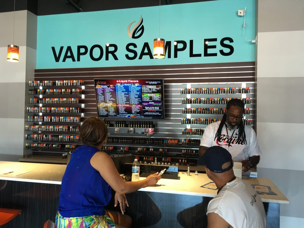 Customers at Vapor Galleria can sample dozens of liquid refills for their e-cigarette devices.