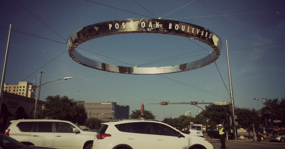 (A signature metal ring street sign along Houston's Post Oak Boulevard near the Galleria in Uptown. Photo: Michael Hagerty, Houston Public Media)