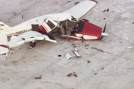 small plane crash on rooftop