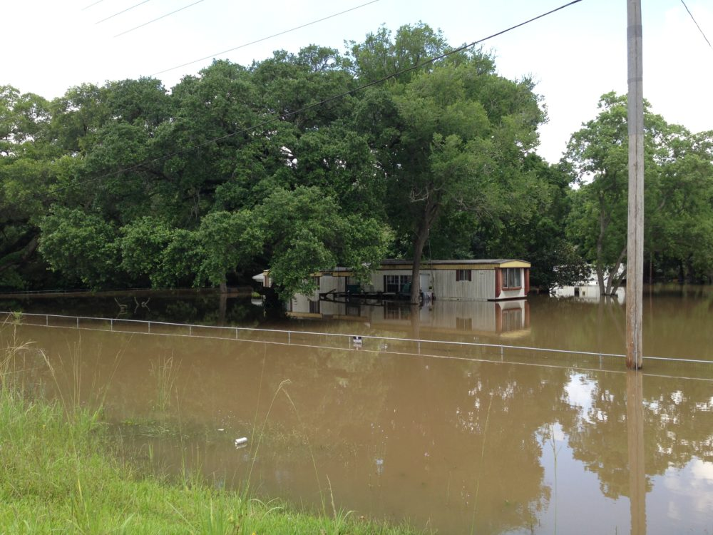 Some parts of Brazoria County are still surrounded by high water. This file photo shows a home located in the Angleton area that was flooded due to the severe weather south east Texas has experienced since the end of May.