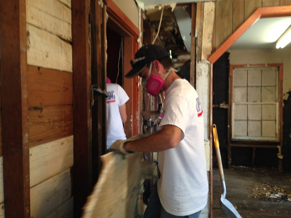 A volunteer working with the group Operation Blessing helps clean up a Rosenberg home located close to the Brazos River that got flooded.
