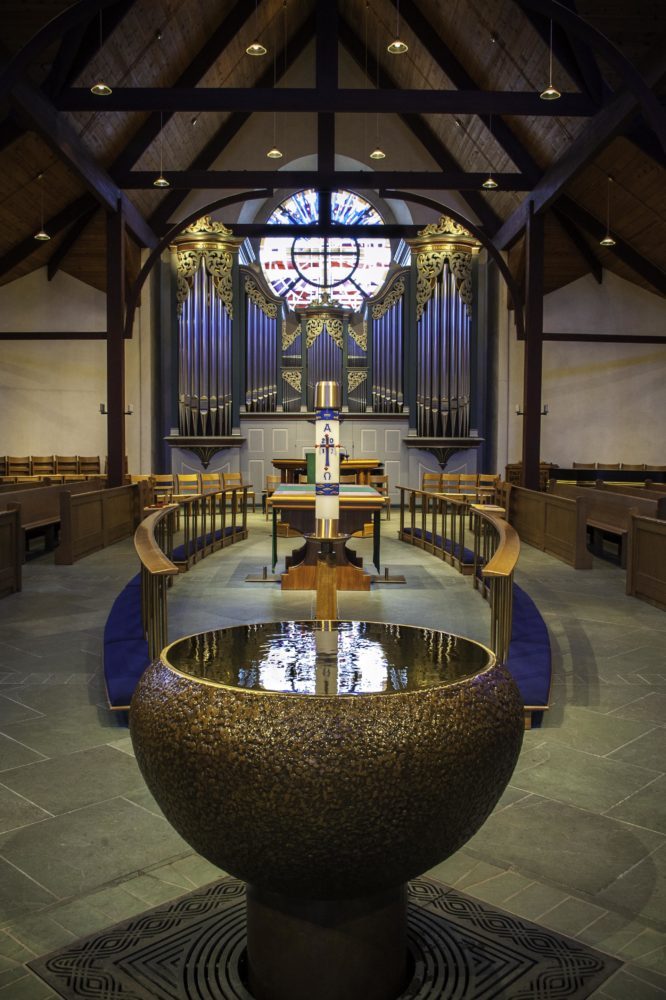 The Baptismal Font at Christ the King Lutheran Church with organ in the background. One of the venues for the convention.