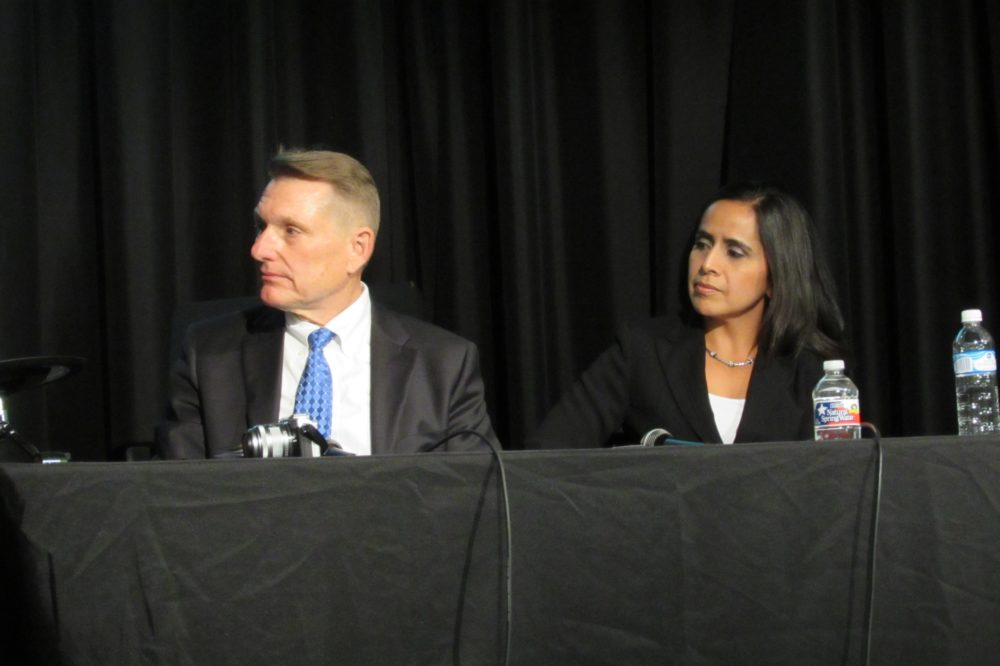 Clark Martinson of the Energy Corridor and Irma Sanchez of the Westchase District listen to questions at a recent transportation forum sponsored by the Energy Corridor and Mobility Houston.