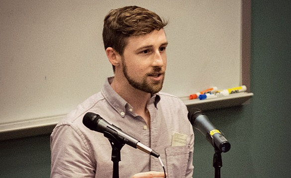 """Scientist Michael McGuire practices explaining his research as an """"elevator speech."""" (Photo Courtesy: UT Graduate School of Biomedical Scientists)"""