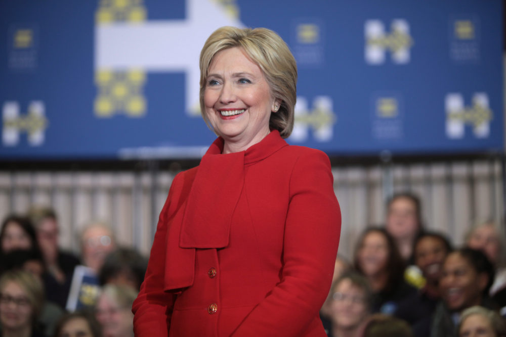 "Former Secretary of State Hillary Clinton speaking with supporters at a ""Get Out the Caucus"" rally at Valley Southwoods Freshman High School in West Des Moines, Iowa."